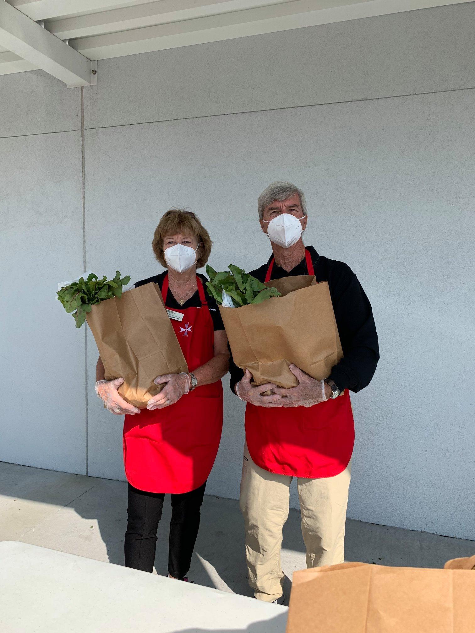 Volunteers Holding Food Drop Bags