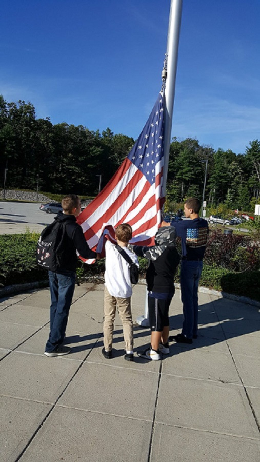 Students hanging flag