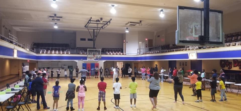 Students gathered in a circle in a gym
