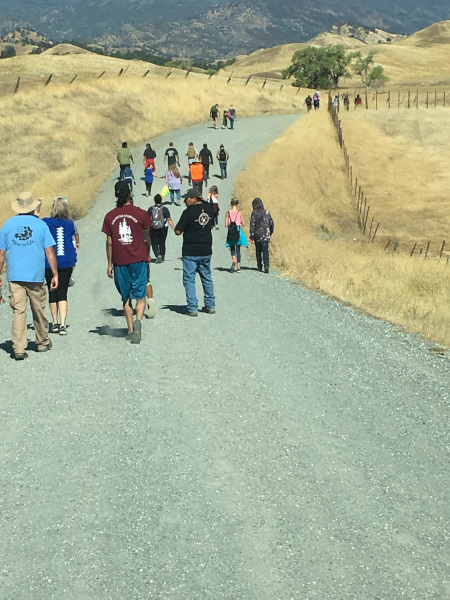 students walking the Nome Cult Trail in memory of their ancestors