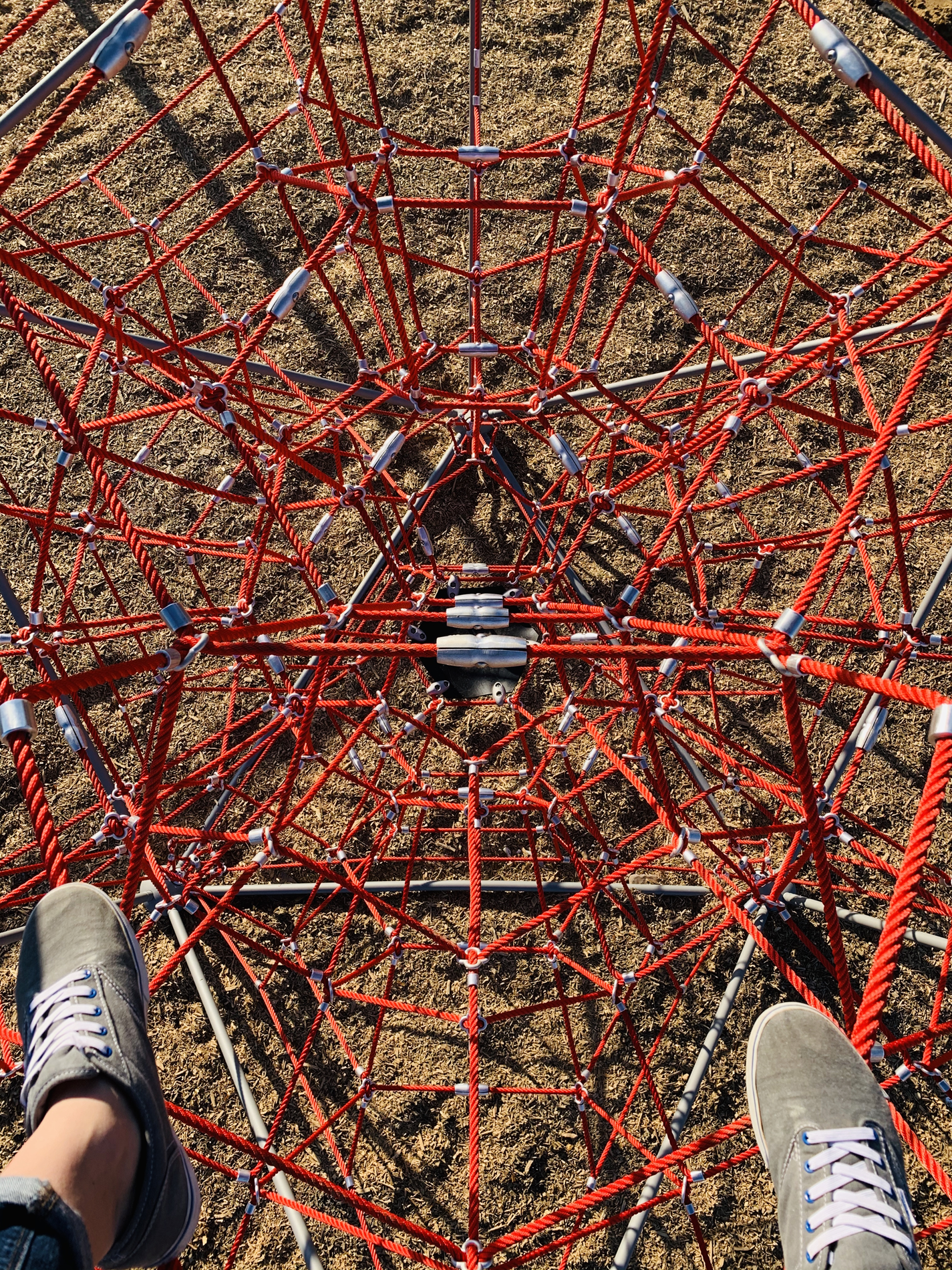 looking down from top of rope-climbing ball