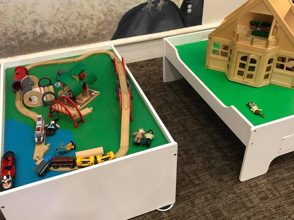 Train table and doll house center for kids' play