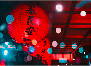 Hanging lit red Chinese lanterns