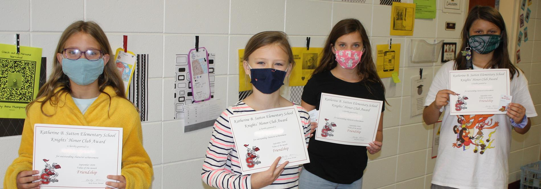 5th Grade Knights Honor Club members show off their certificates.