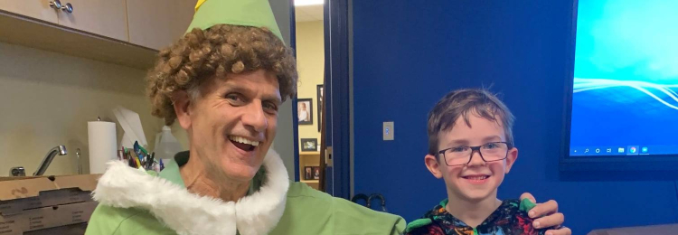 Student and Elf dressed up for Festive Attire Day