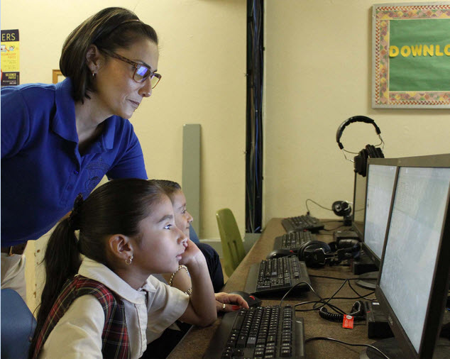 Teacher and student at the computer