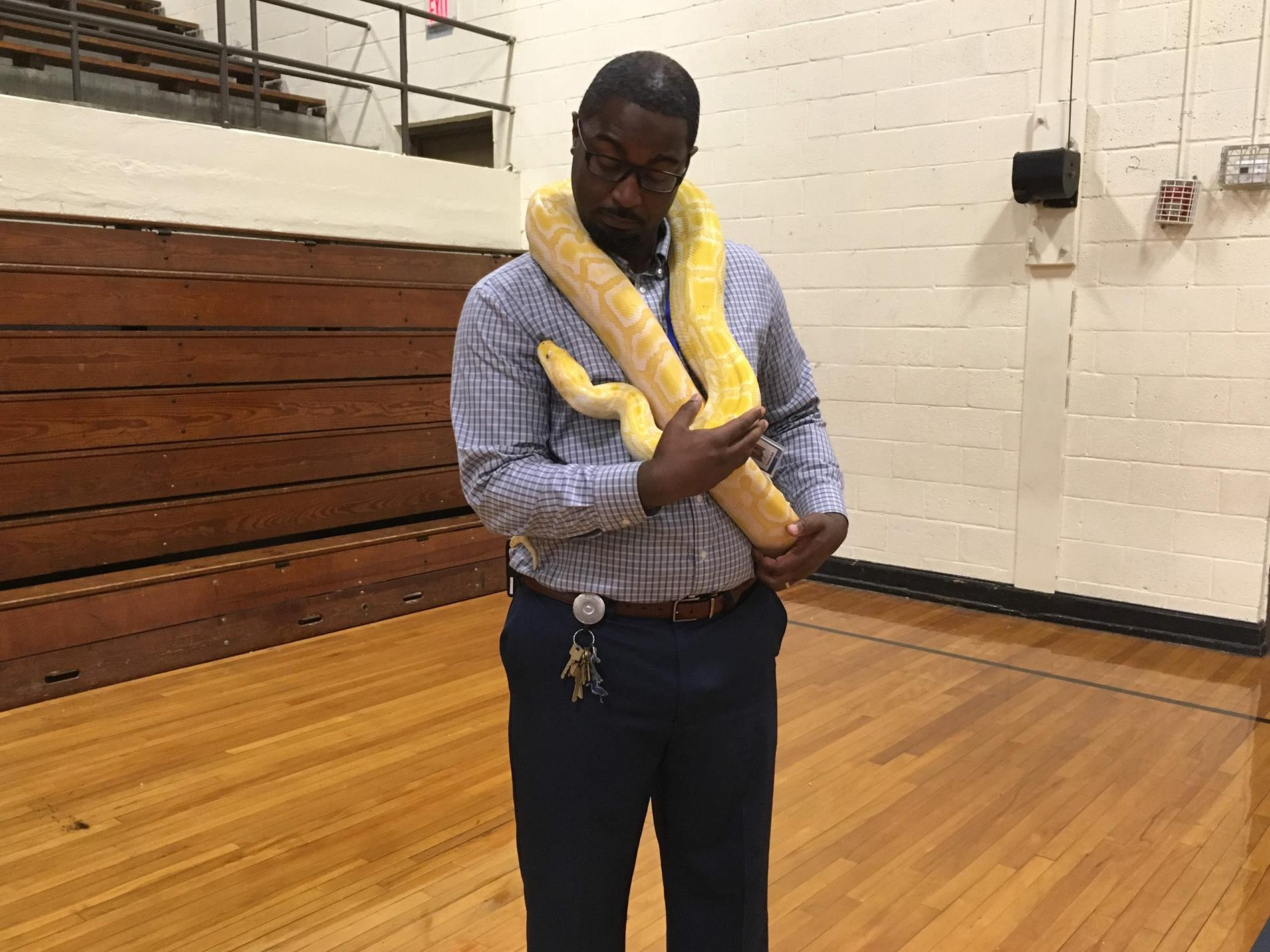 Mr. Kirk is holding a big snake