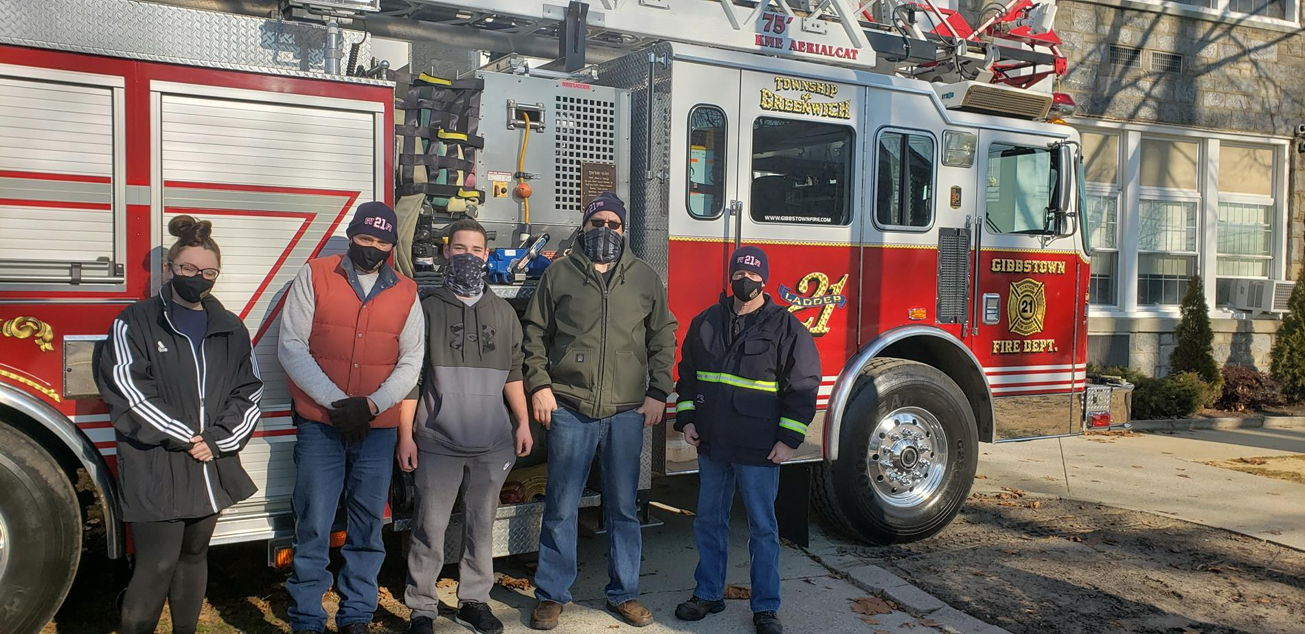 Members of the Gibbstown Fire Department pose in front of Fire Truck after rescuing Old Glory.