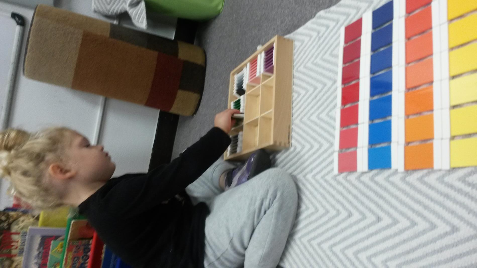 Child working with color cards