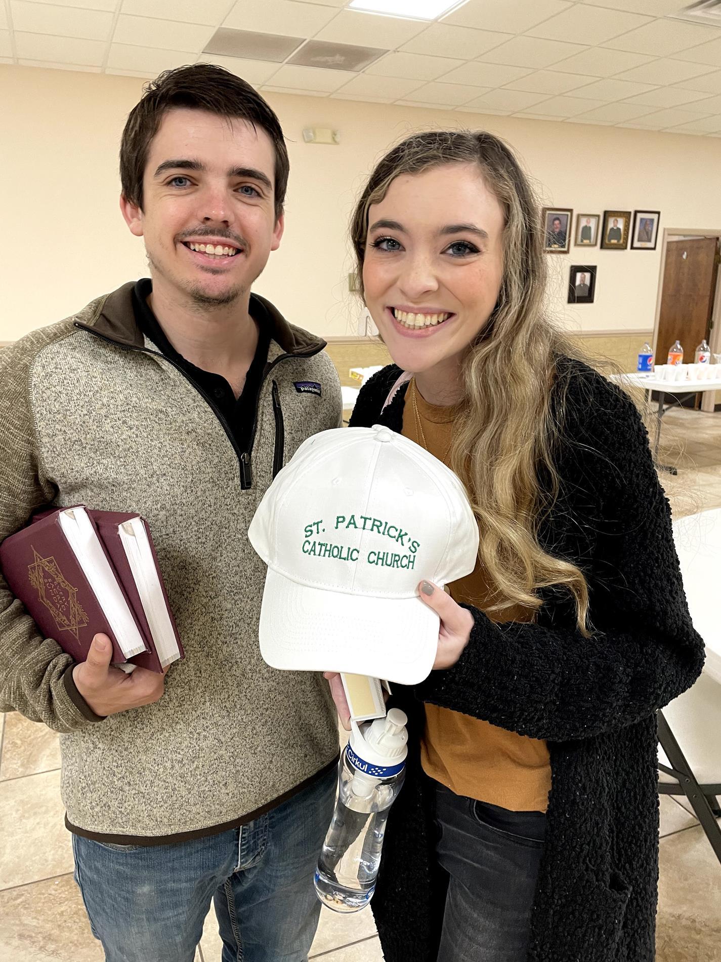 Gracie and Matt showing off their St. Patrick ball cap winnings.