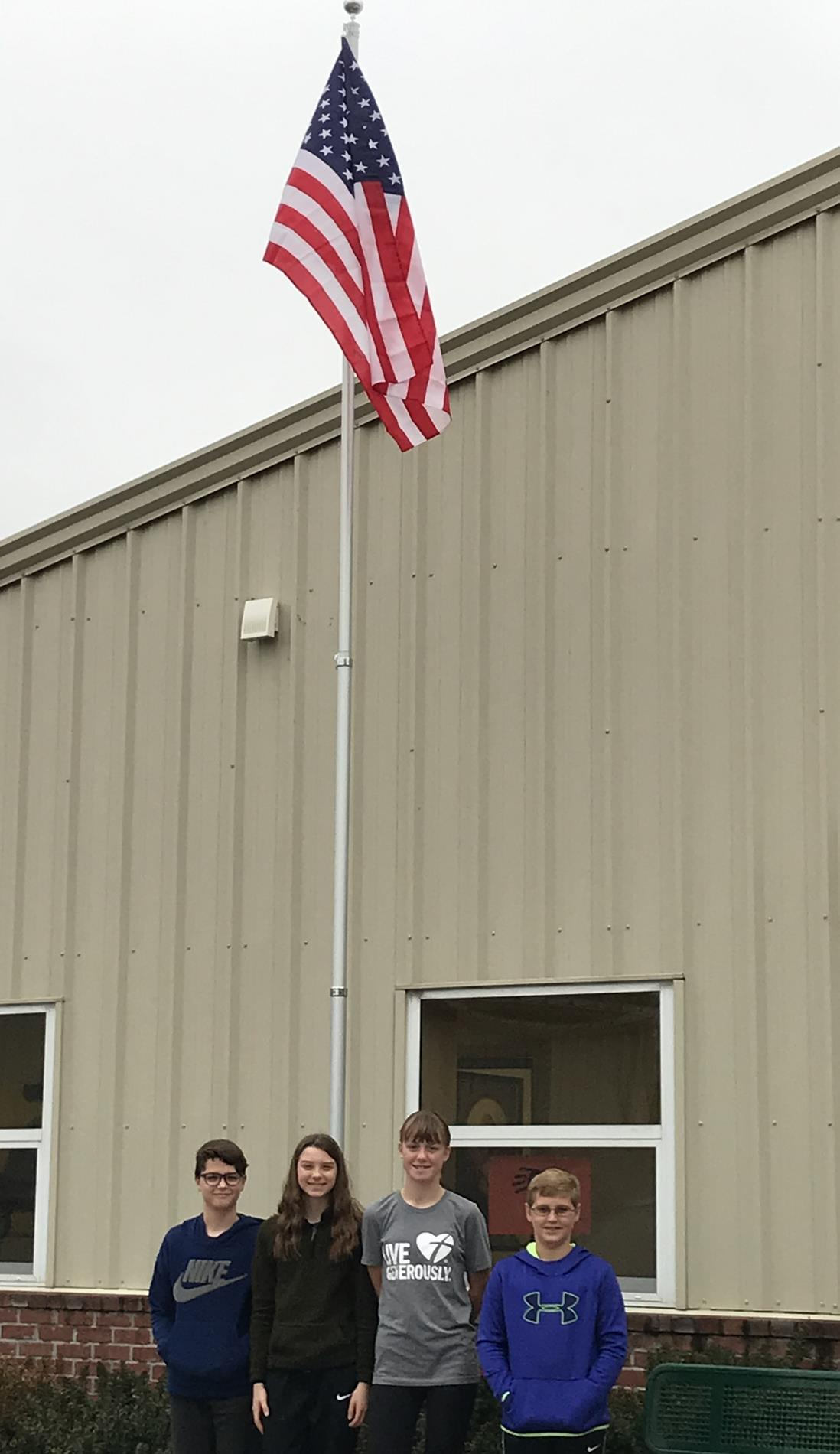 students with flag pole