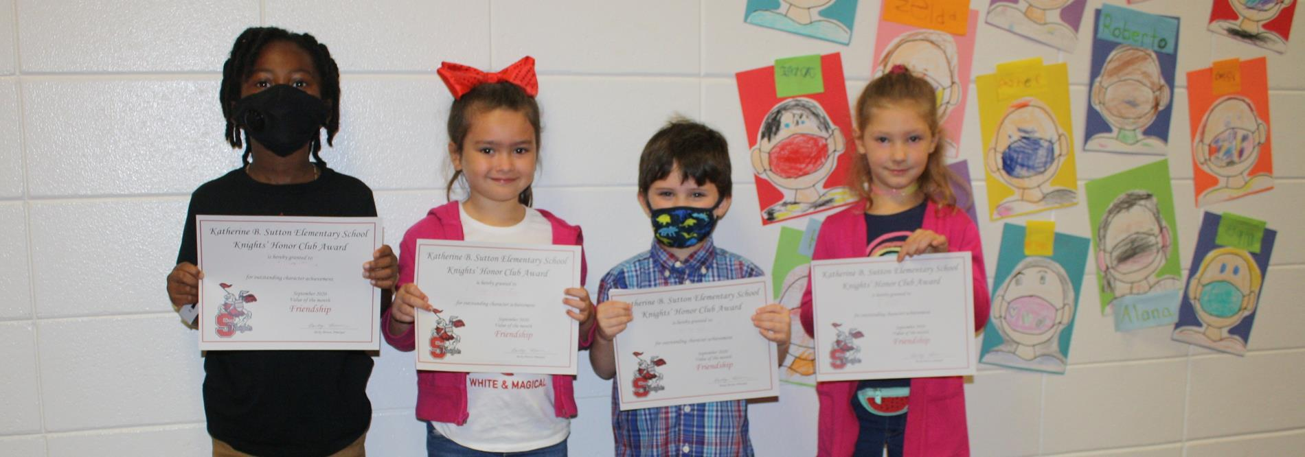 Students hold their certificates for Knights Honor Club