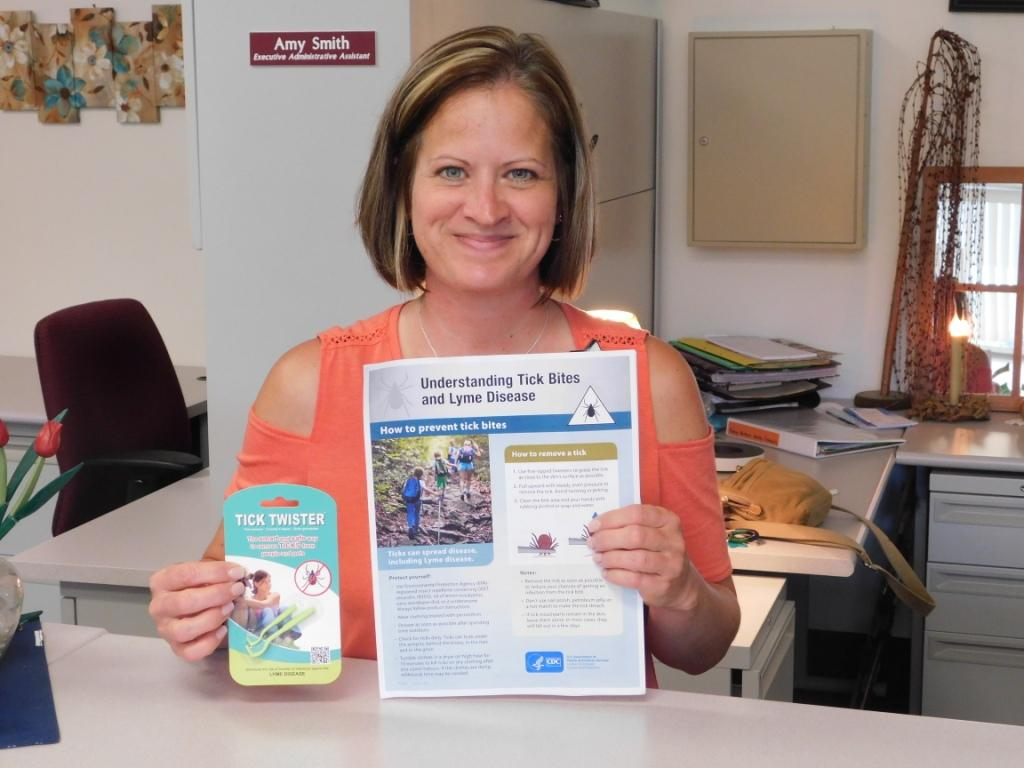 Bradford-Tioga Head Start, Inc. Executive Administrative Assistant Amy Smith displays the informational flyer and tick removal tool that were provided to each 2018-2019 enrolled family.