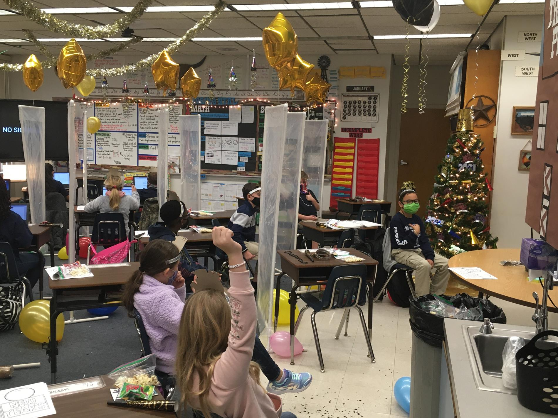 Classroom decorations with balloons and streamers hanging
