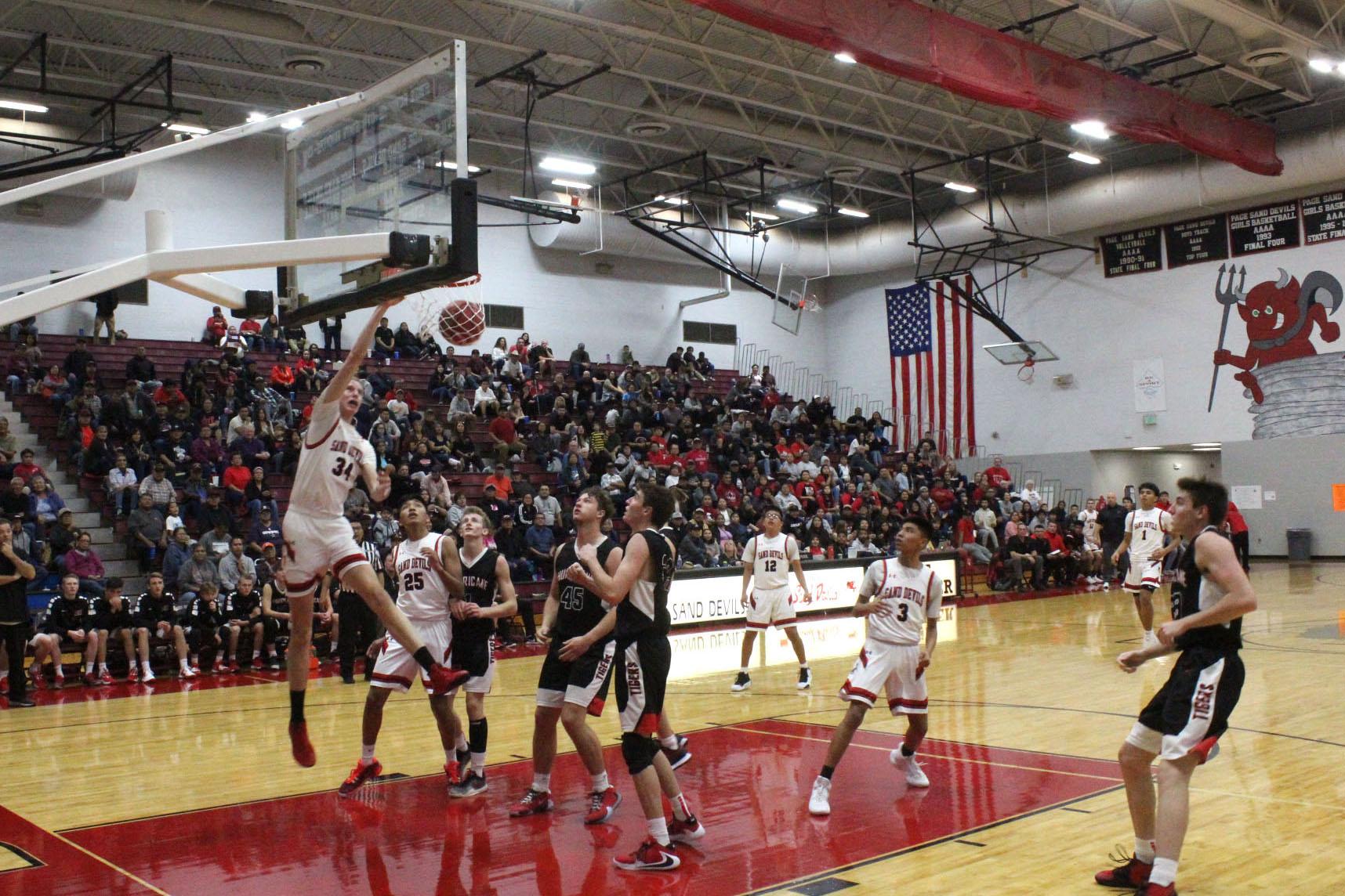 Stu dunks basketball