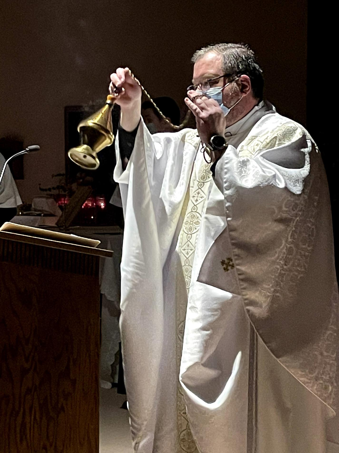 Fr. Weiss incenses the altar and ambo