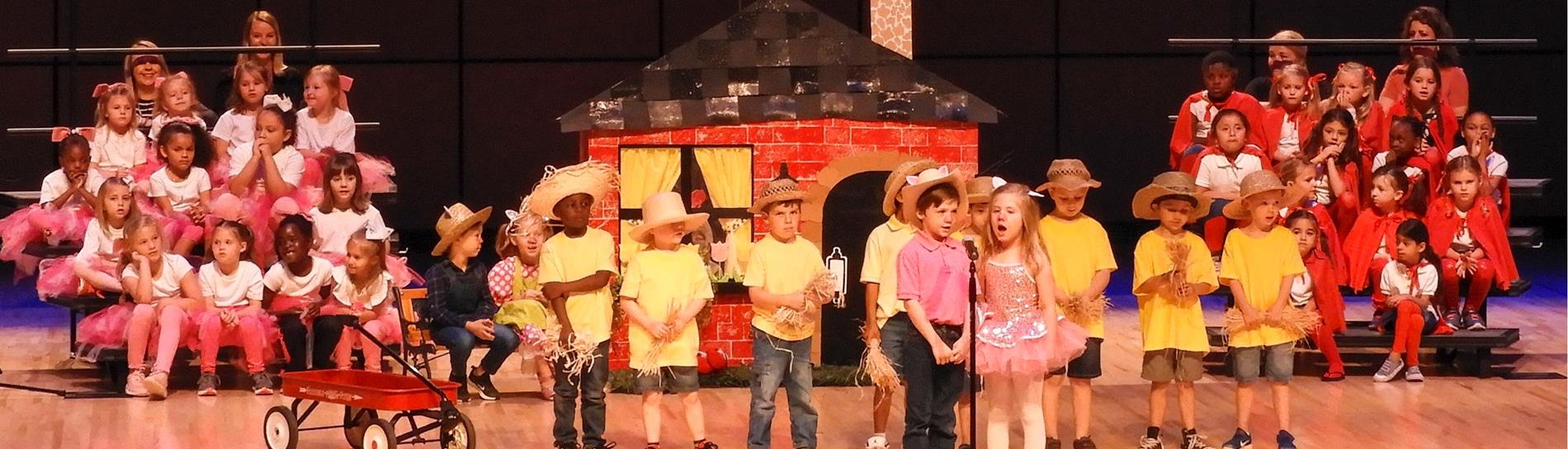 Group of students performing at The Three Piggy Opera