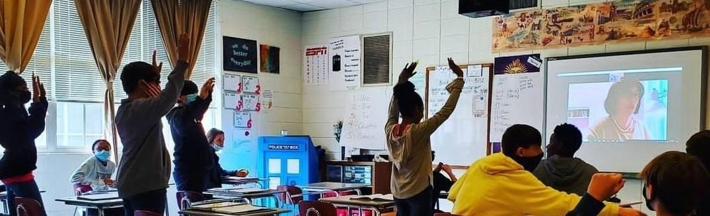 Students learning from Italian professor