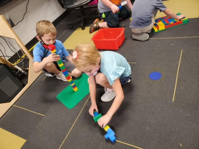 These kids practice their counting skills while being hands-on in their learning.