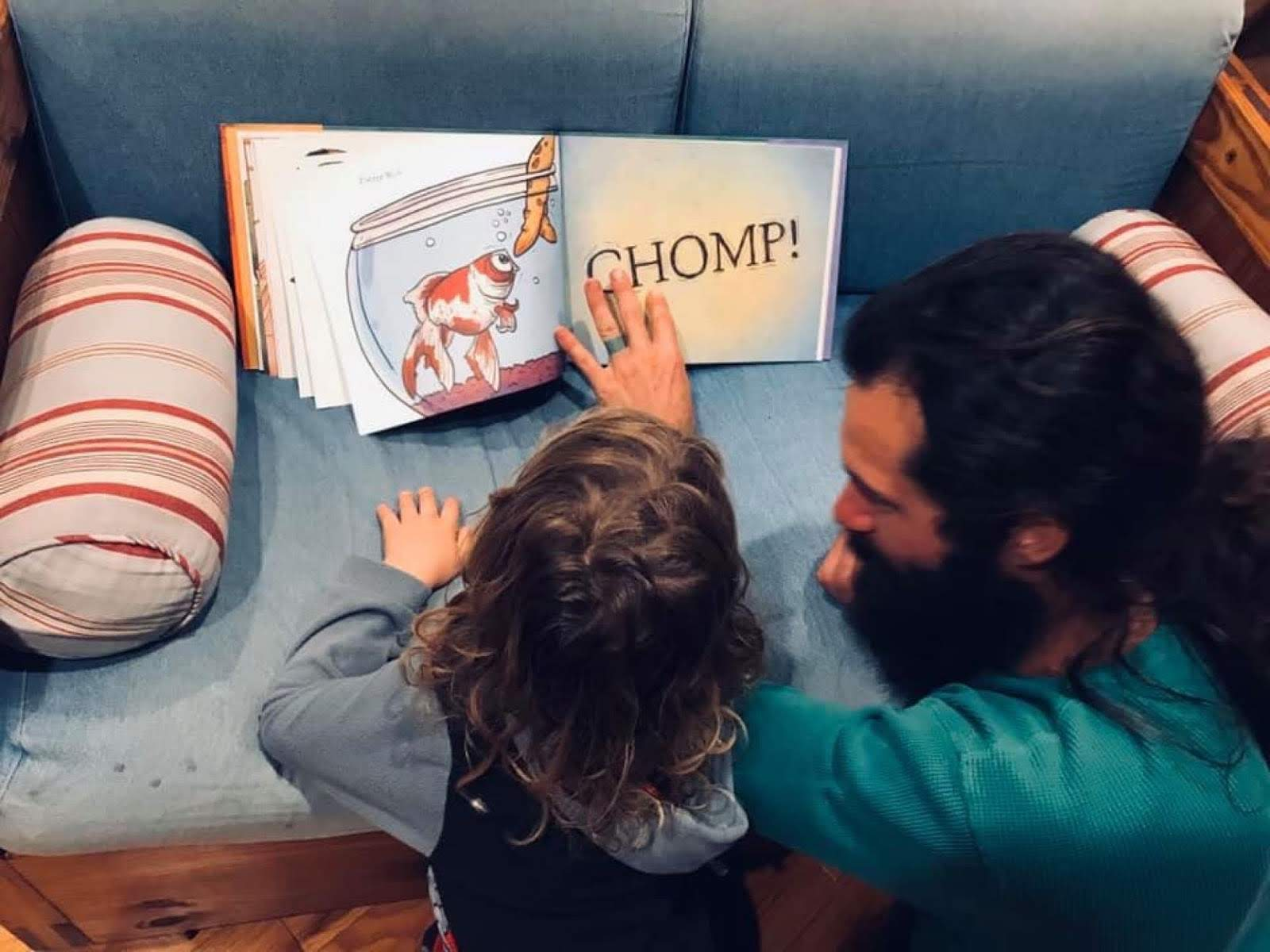 photo of dad reading a picture book with a toddler