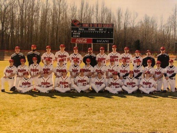 Baseball Team posing at field
