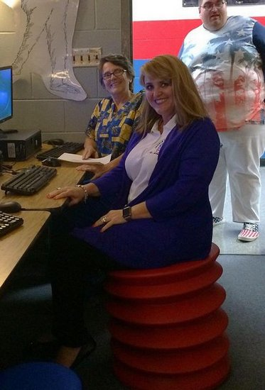 Principal Dakas tries out the new flexible seating provided to DMS by CSH.