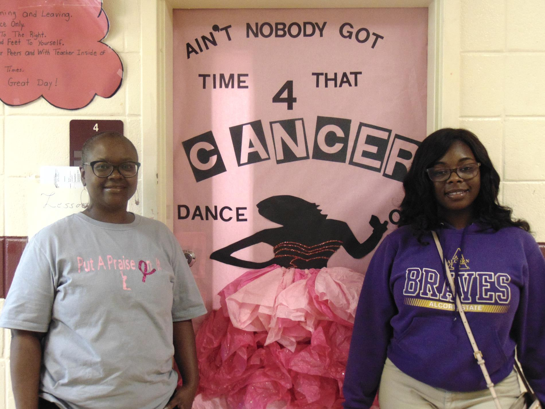 Eboni Winder and mother with Breast Cancer Awareness door design