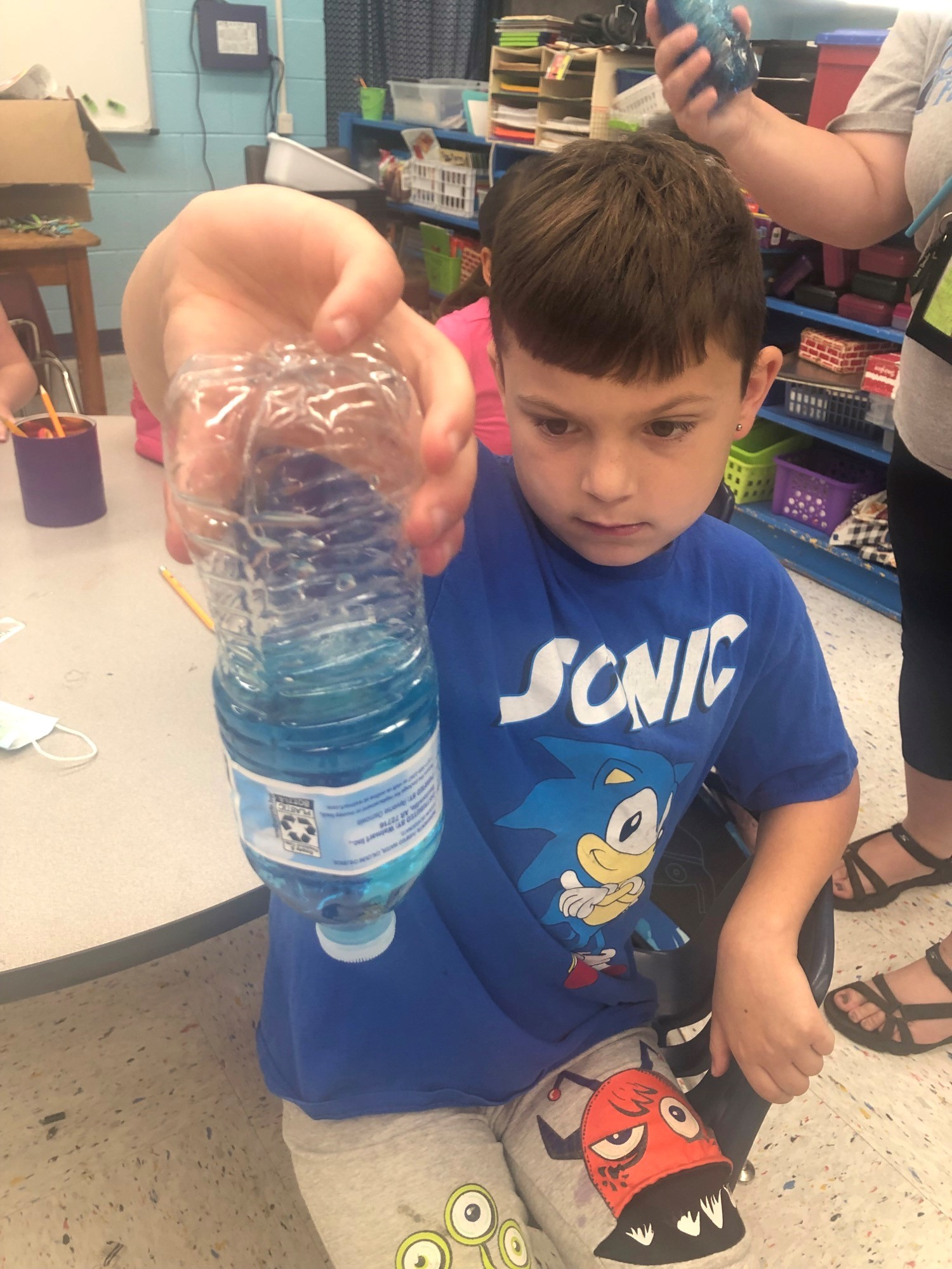 Washburn School Summer Camp student doing a weather experiment.