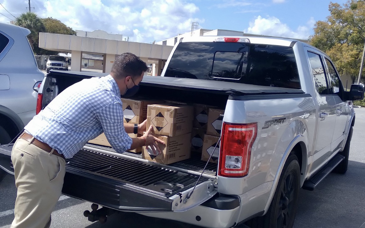 Mr. Fann loading the boxes for our school into his truck.