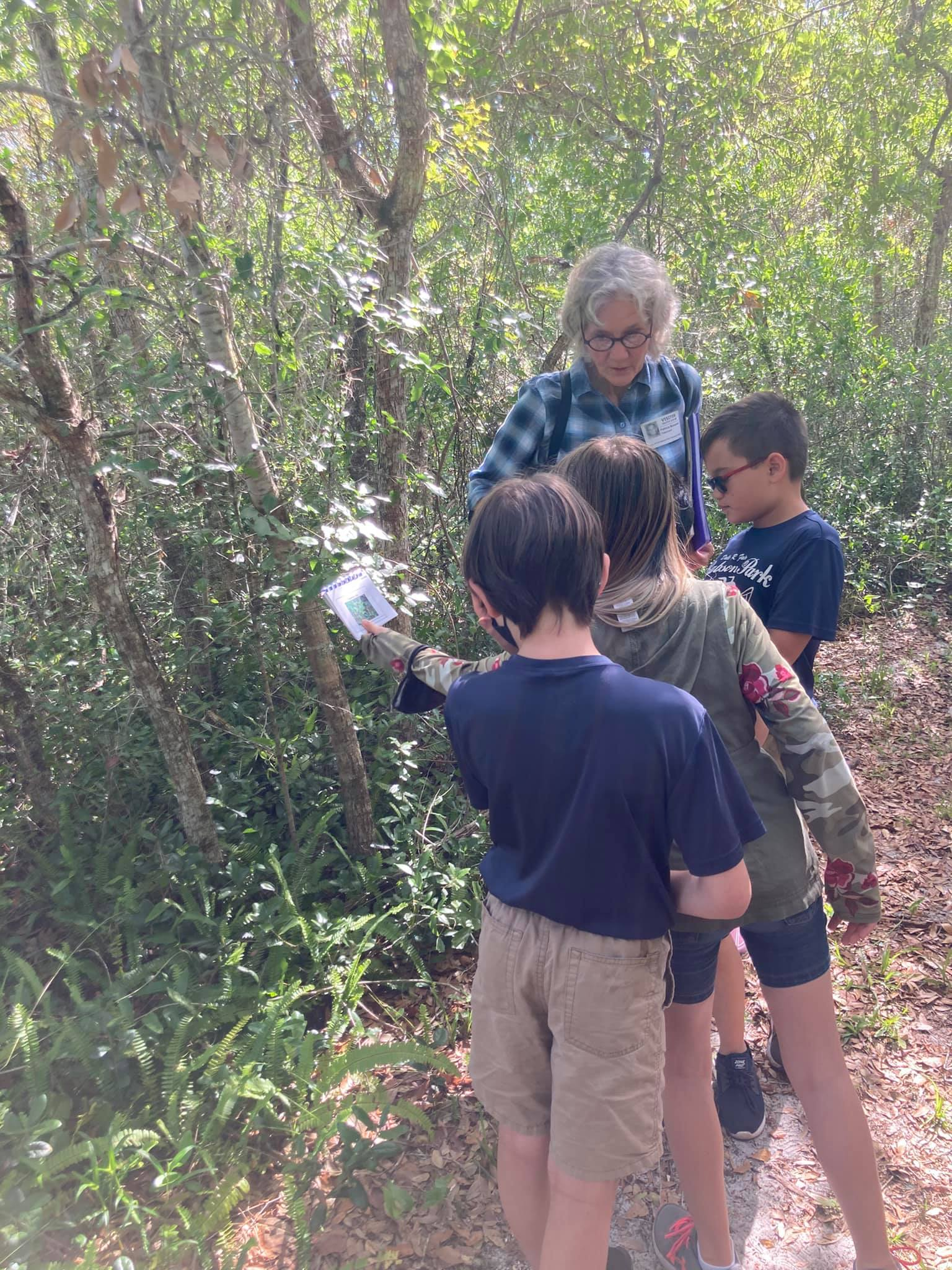 Students learning information from their trail guide.