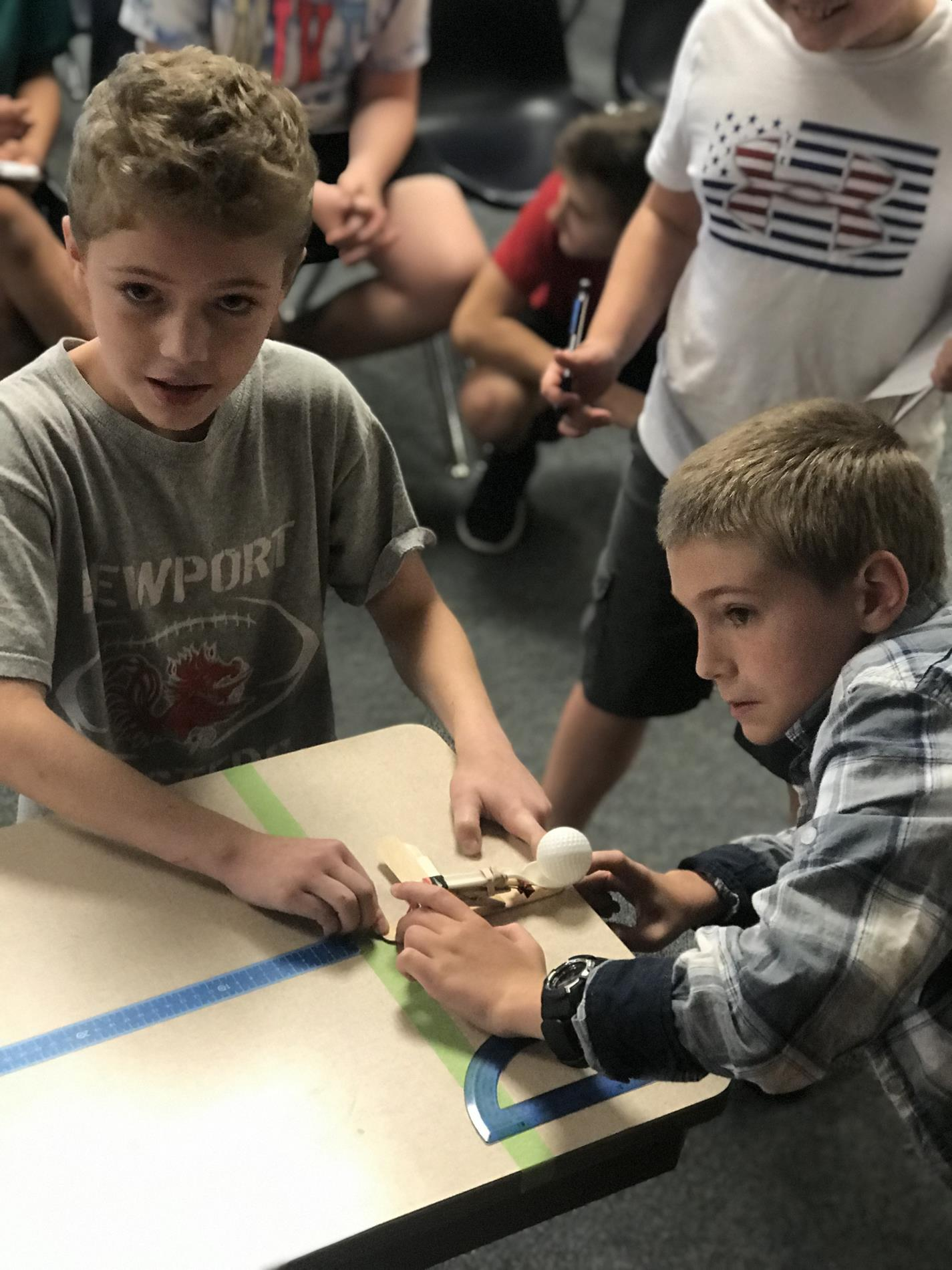 Students testing catapults