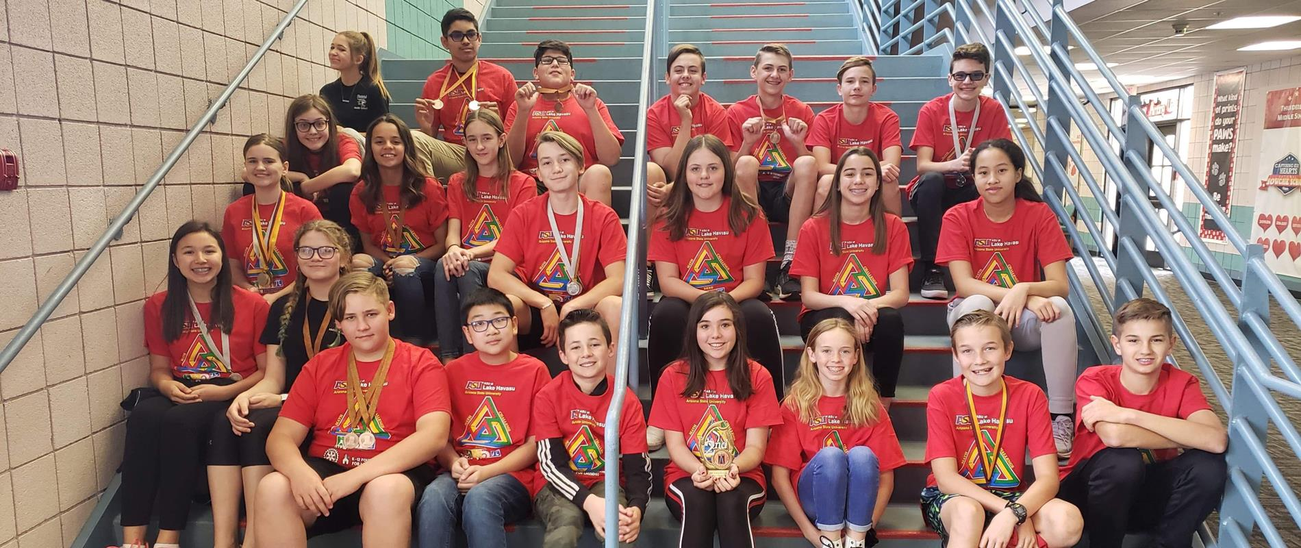 picture of students with Math Olympics medals