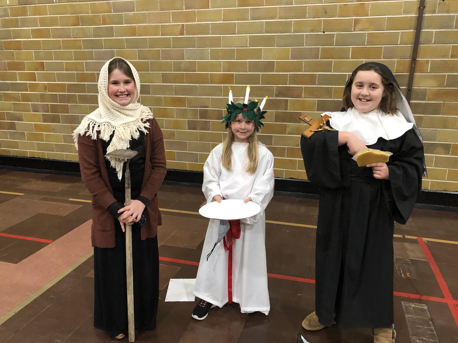 Three children dressed as saints