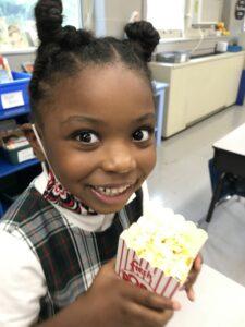 girl holding popcorn