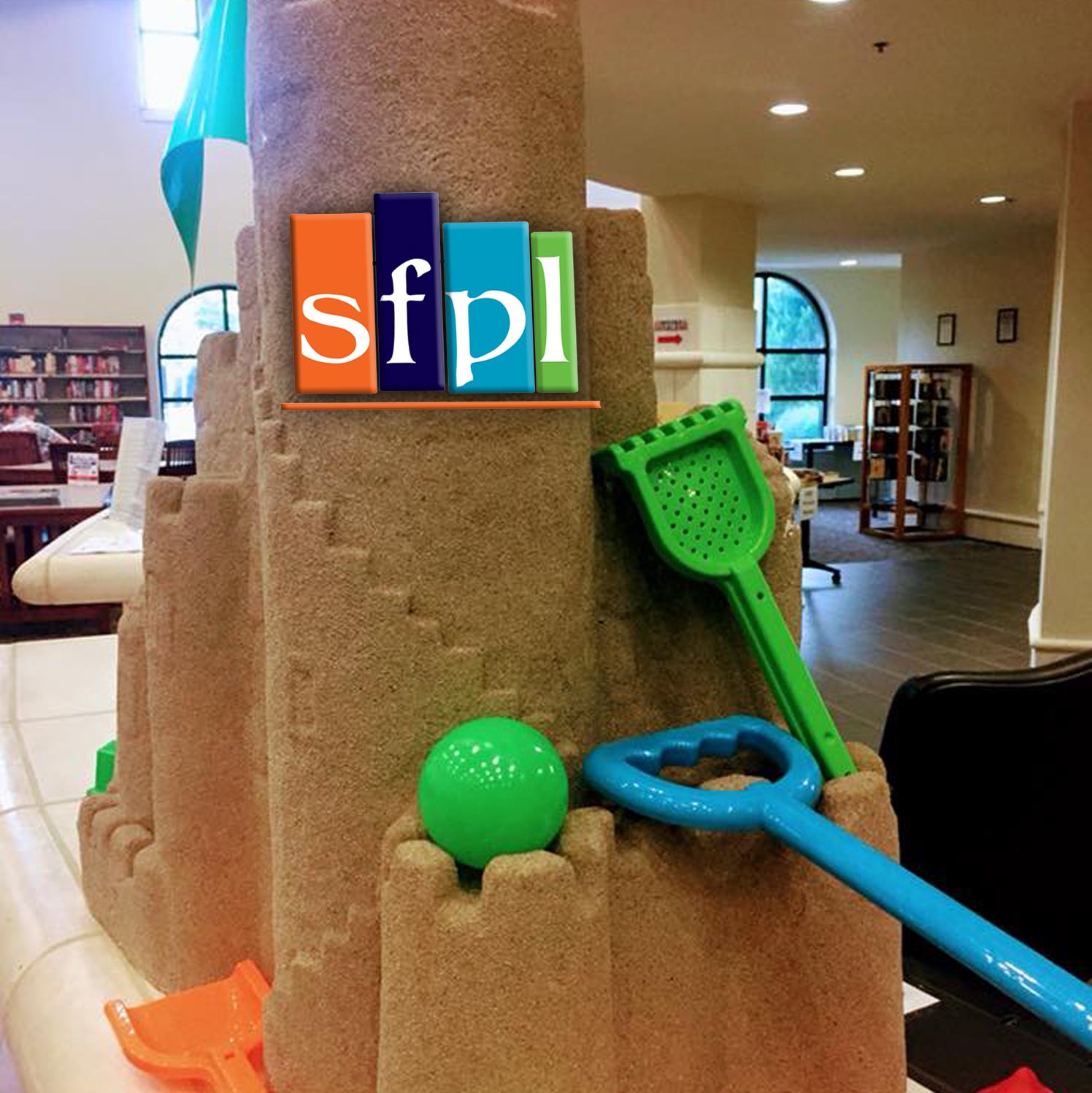 SFPL sandcastle on counter at front desk