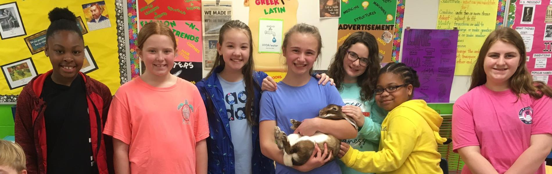 Mrs. Ready's 5th grade students with a rabbit