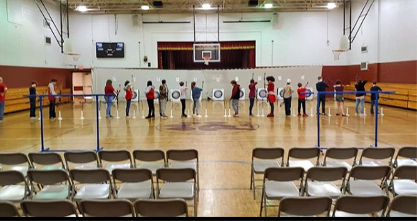 PJHS archers on the line shooting in the gym