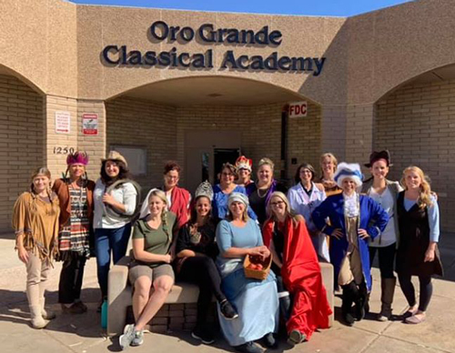 staff in front of school in costumes