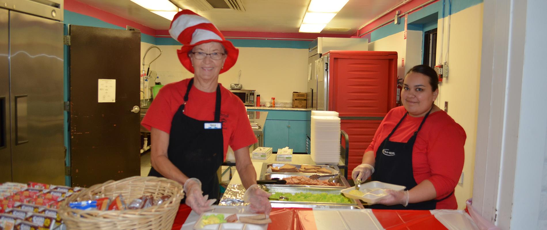 picture of kitchen staff serving Green Eggs & Ham