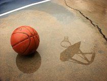 Basketball sitting on court