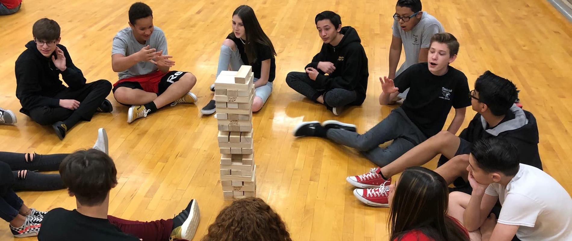 picture of students playing giant jenga