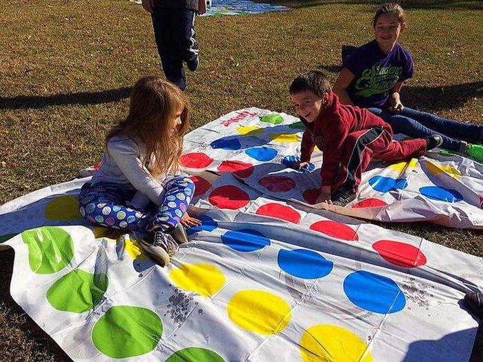 Kids having fun with playing twister.