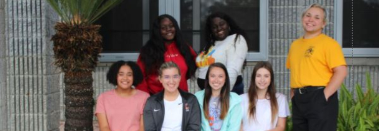 TCHS Yearbook staff and counselor