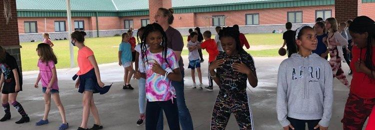 TCES students and staff dancing