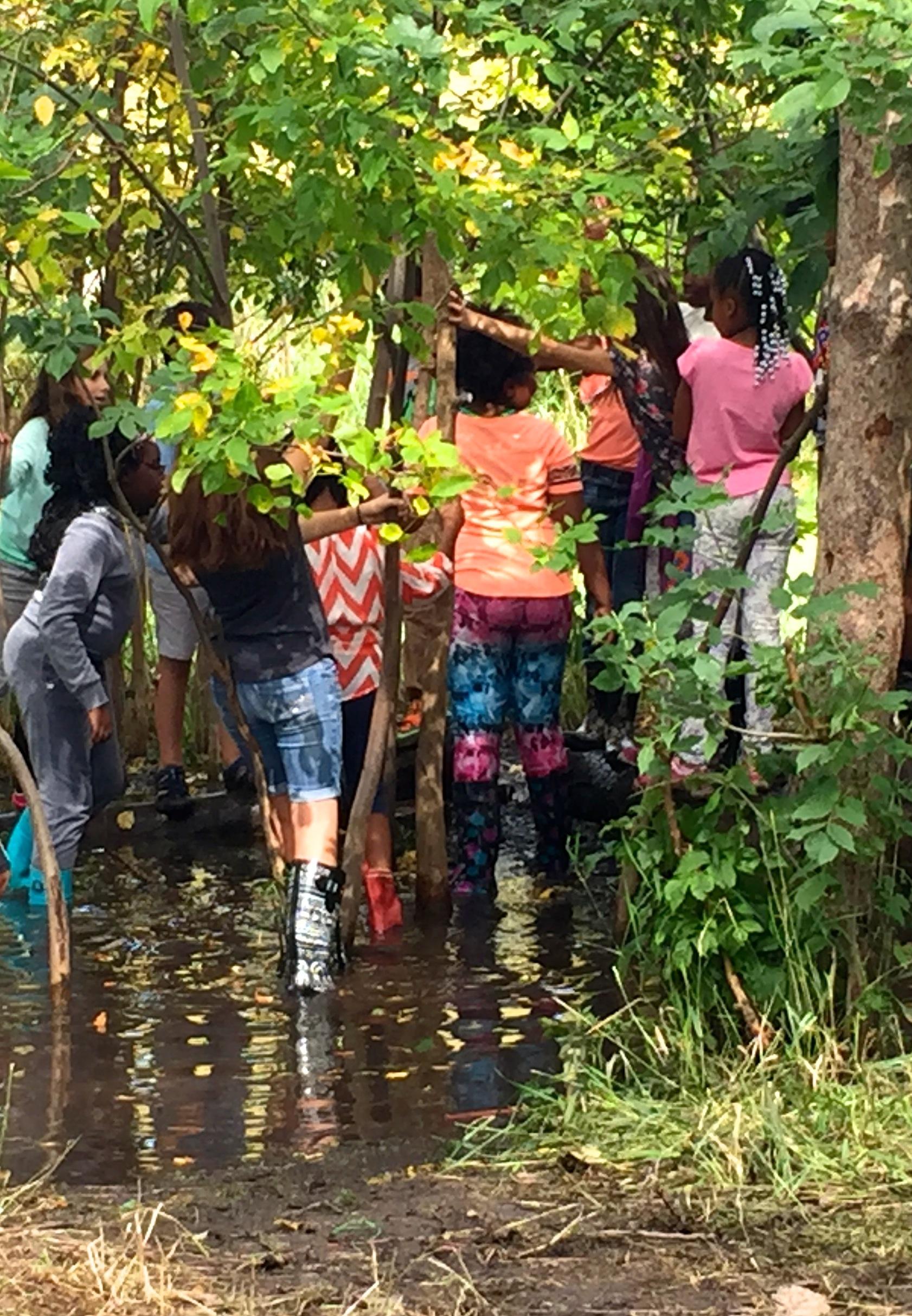 Children walking in pond