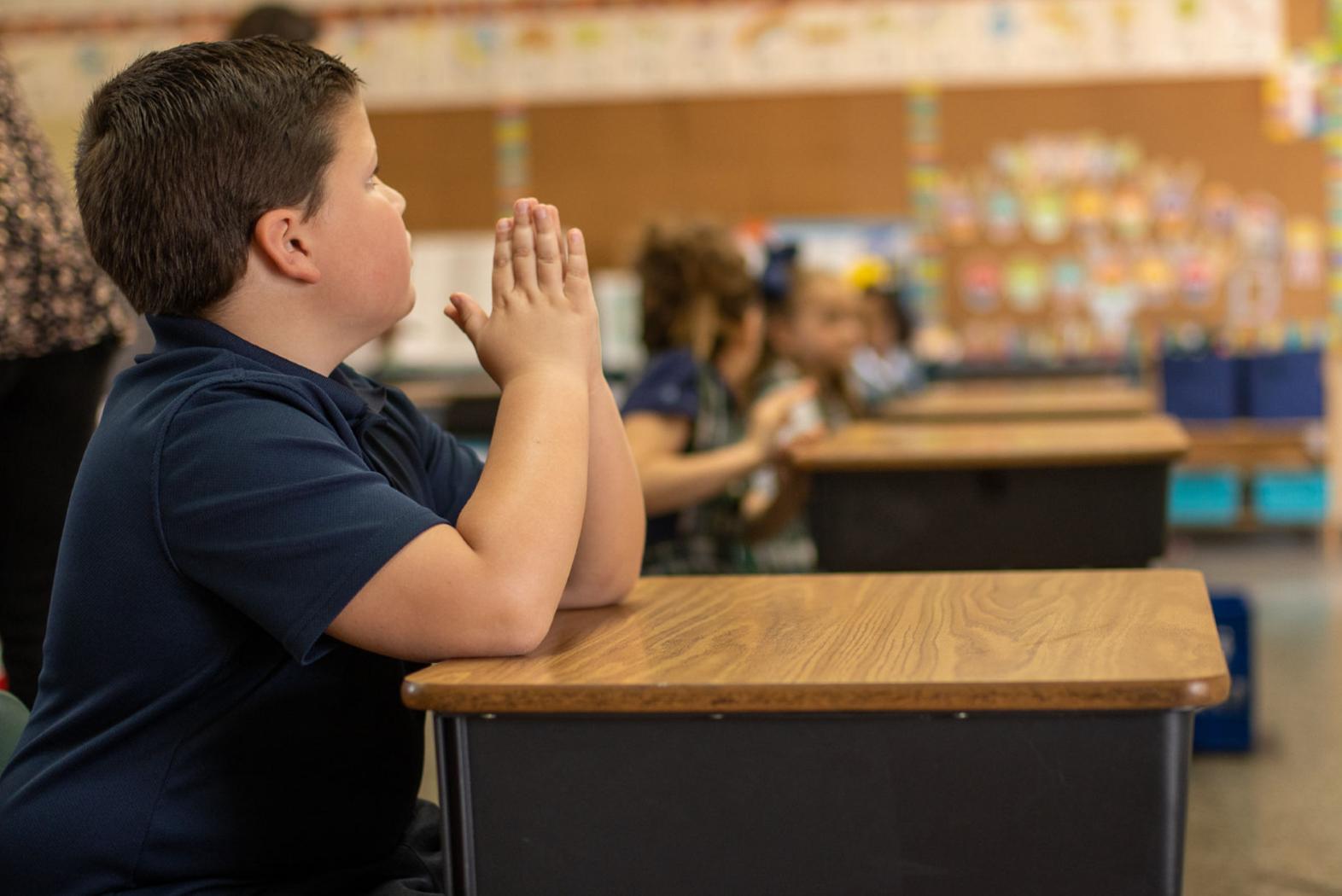 Luke F. praying