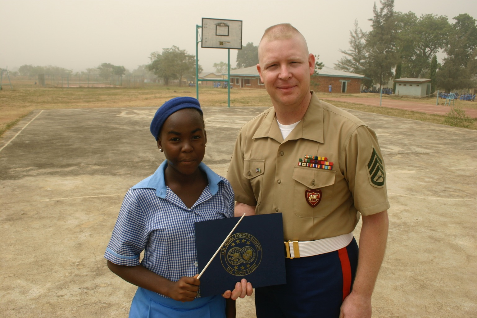 Taken at the Government Girls School outside Abuja, Nigeria after our performance. This young lady was our guest conductor. circa 2009.