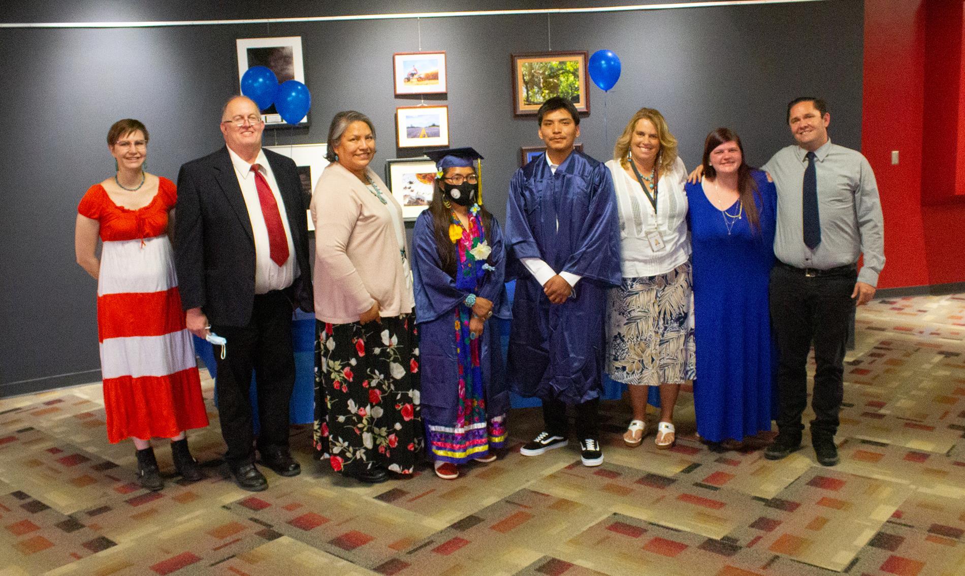 Staff and graduates.