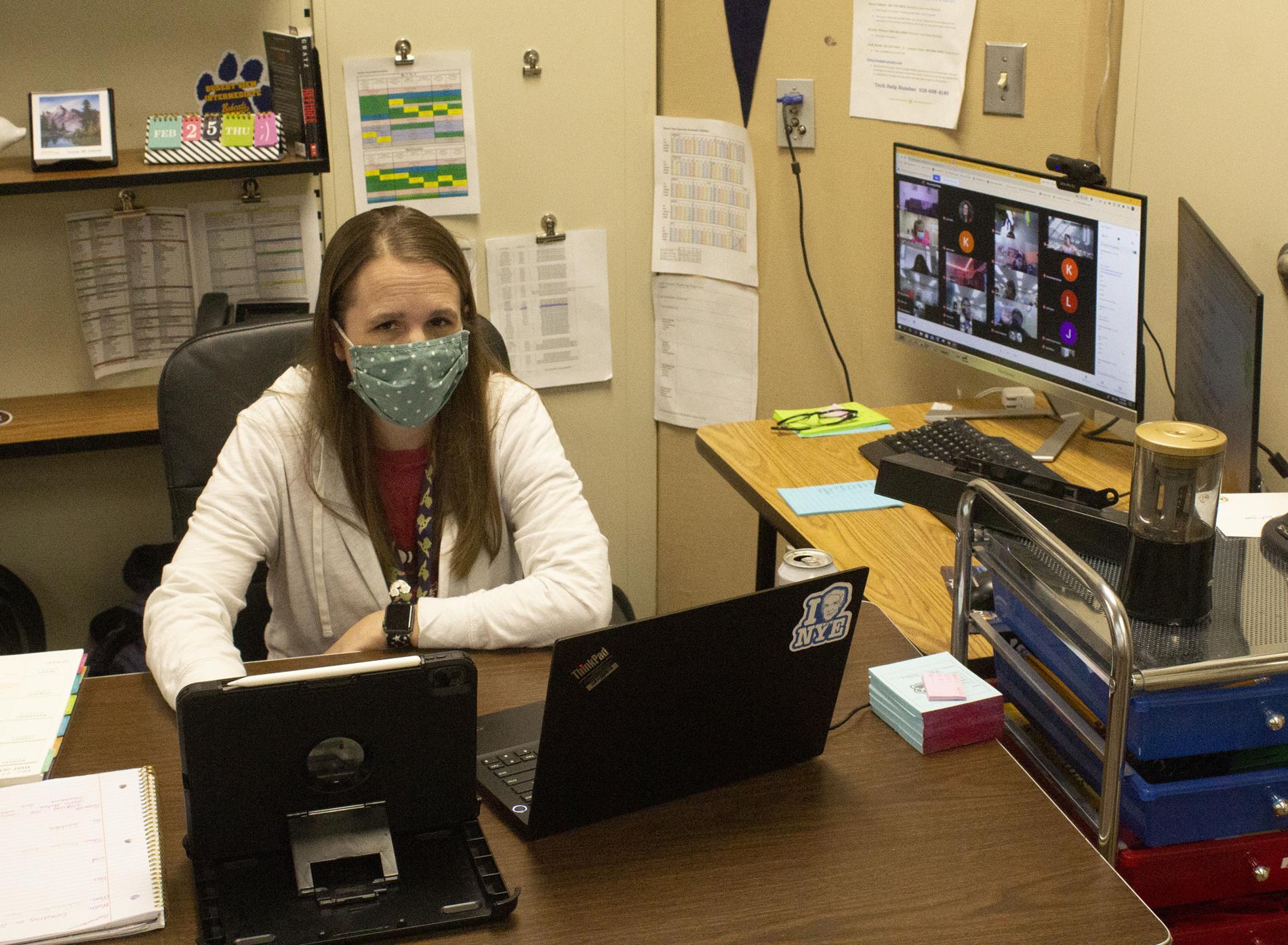 Mrs. Talbot at her desk.