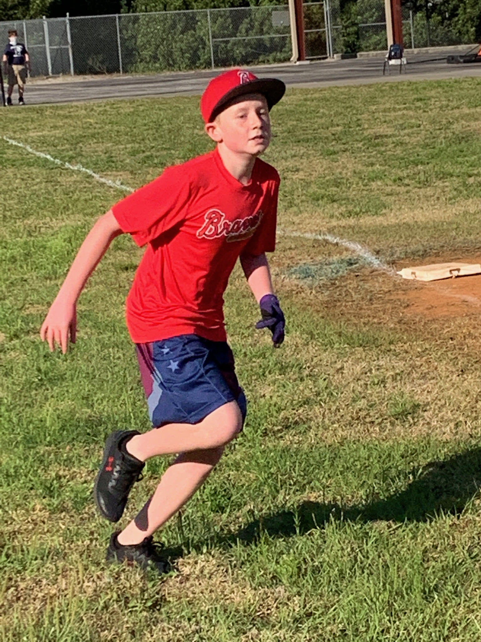 A 5th grade student running the bases.